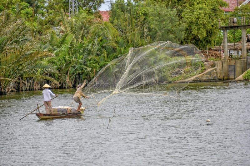 越南渔夫在会安市 图库摄影