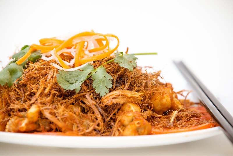 越南烹调- Sauté有被油炸的香茅的青蛙腿 库存照片