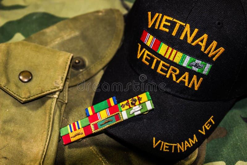 越南经验丰富的盖帽、丝带&囊 免版税库存图片