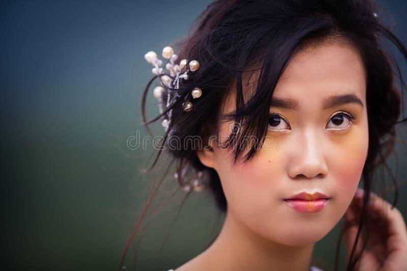 越南年轻美丽的浅黑肤色的男人 免版税库存图片