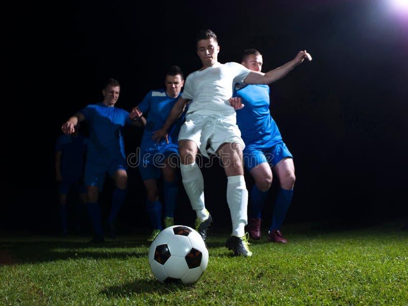 足球运动员决斗 库存图片