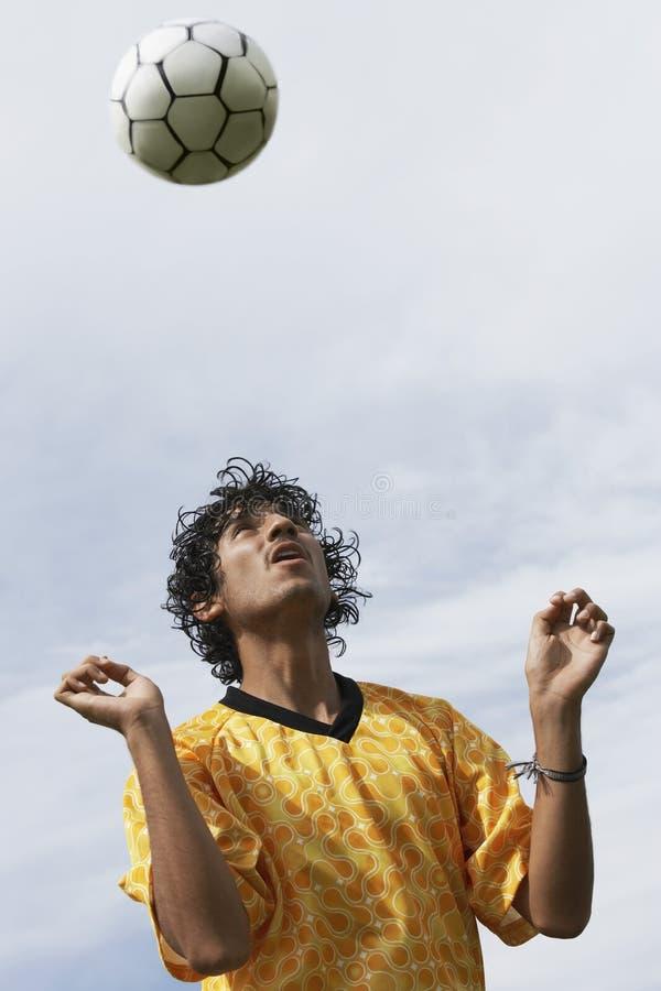 足球运动员标题球 免版税图库摄影