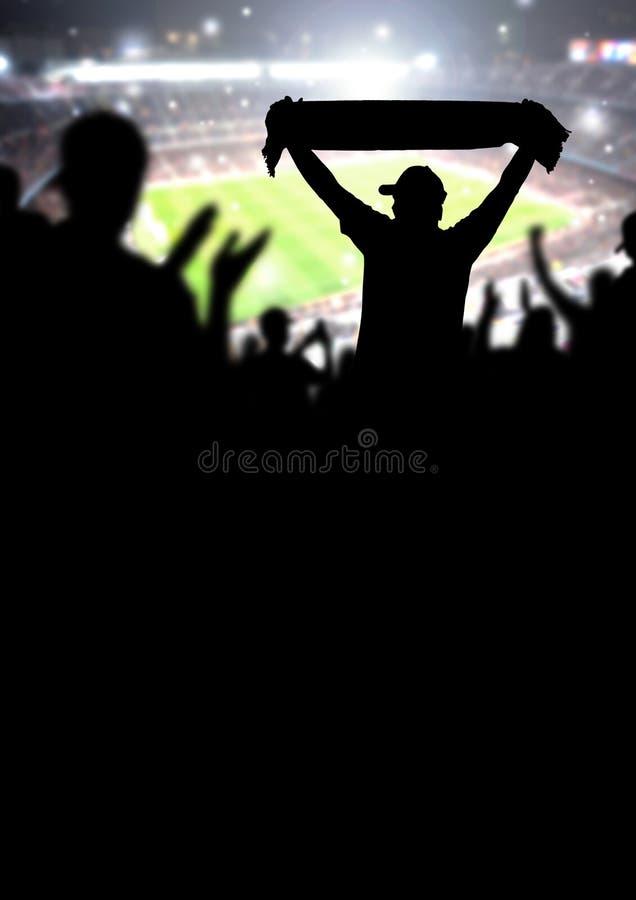 足球迷或足球人群背景 s的剪影人 库存照片