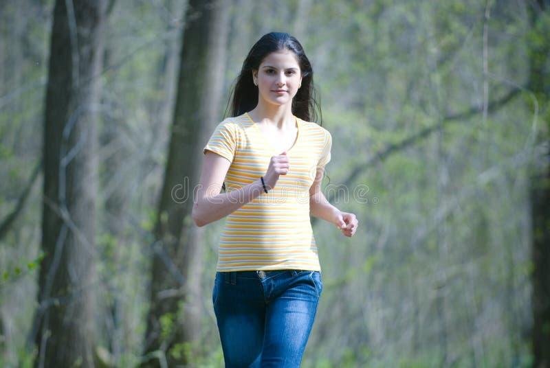 跑步的妇女年轻人 免版税图库摄影