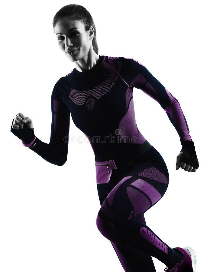 跑步被隔绝的剪影阴影的妇女赛跑者连续慢跑者 免版税库存照片