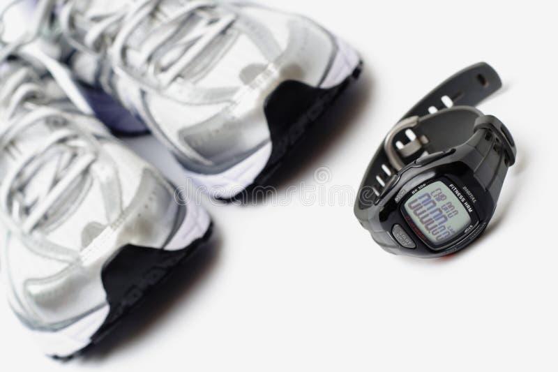 跑鞋体育运动手表 免版税库存照片