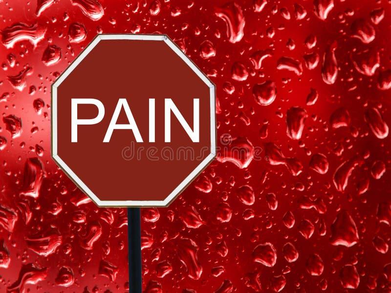路标中止痛苦和红色血液下落在玻璃 免版税库存照片