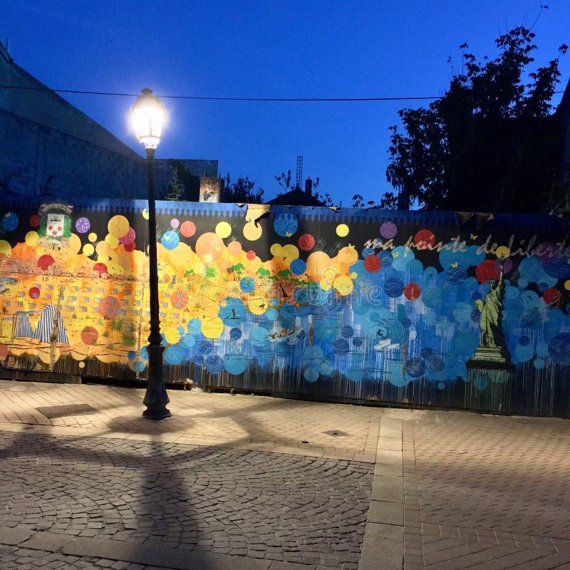 路灯柱enlighted的街道艺术 免版税库存照片