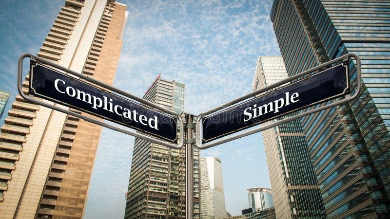 路牌简单对复杂化 免版税库存图片