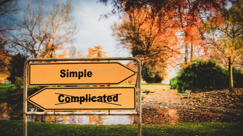路牌简单对复杂化 免版税库存照片