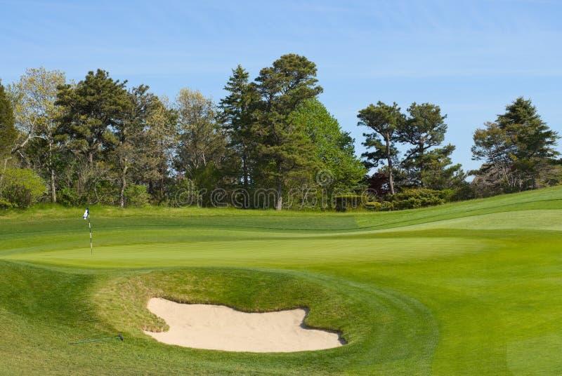 路线高尔夫球绿色放置的砂槽 图库摄影