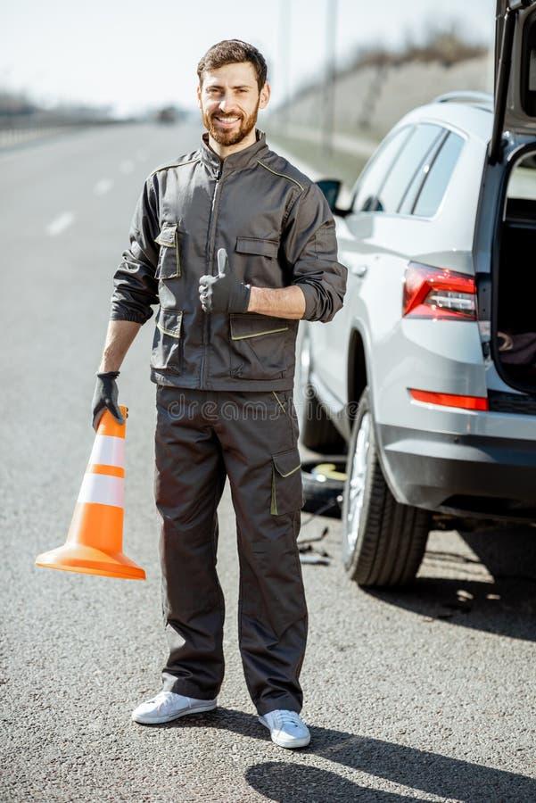 路路旁的协助工作者 库存照片