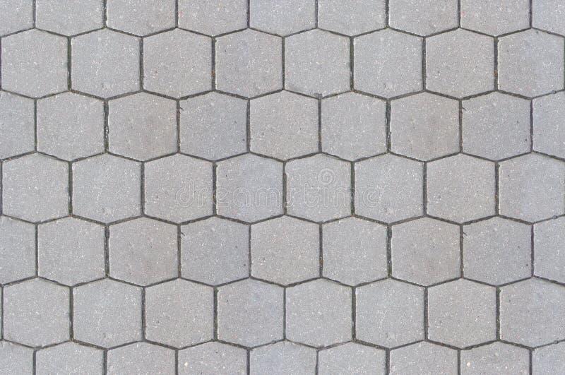 路路面纹理背景关闭/六角形样式水泥边路 库存图片