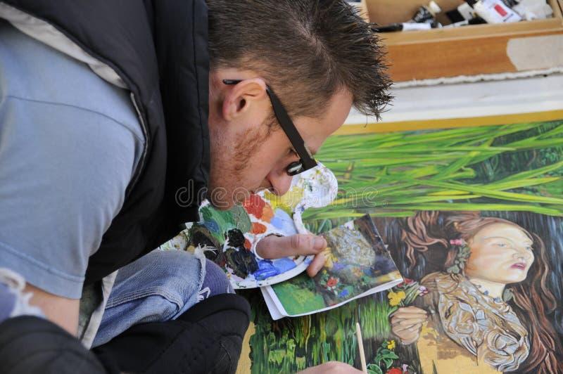 路面街道艺术家的特写镜头 库存照片