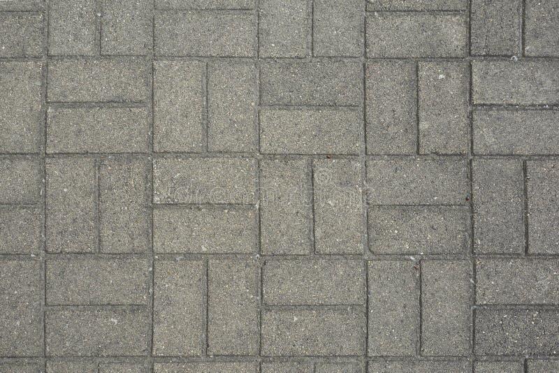 路面铺磁砖背景 纹理关闭 图库摄影