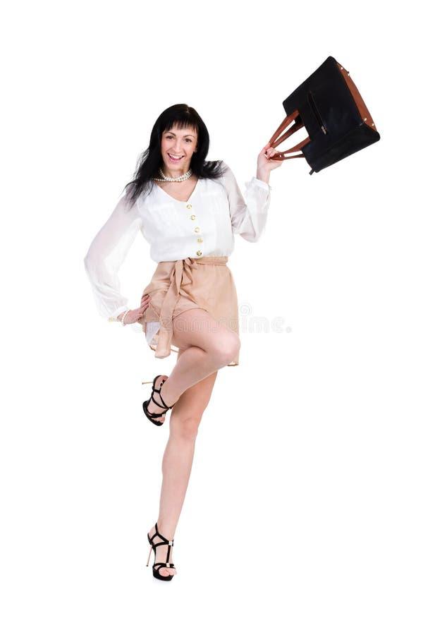 跳与袋子的愉快的购物妇女 库存图片