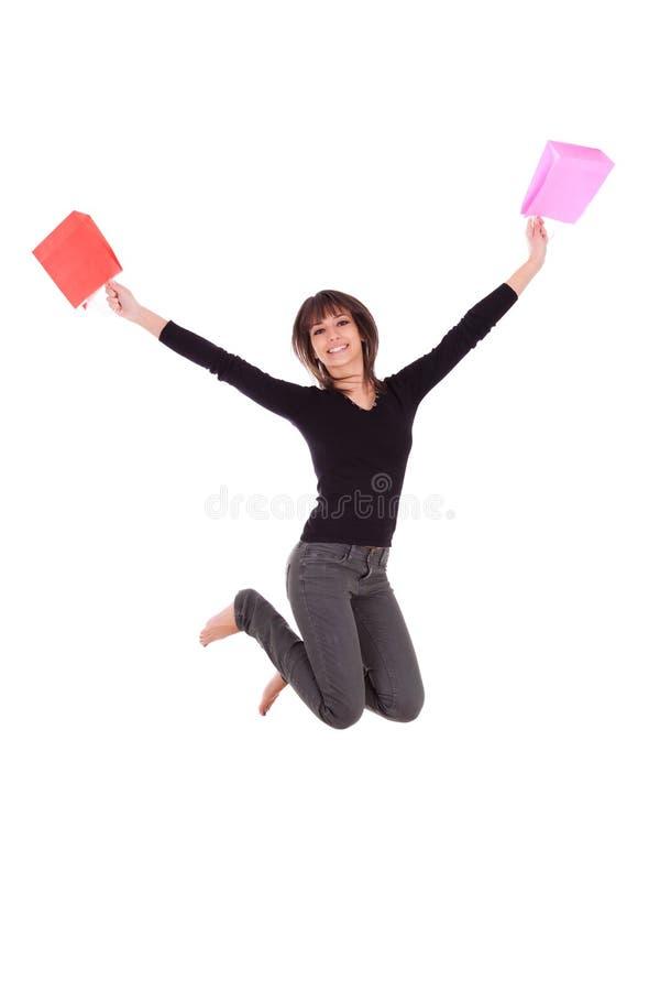 跳与购物袋的愉快的白种人妇女 图库摄影
