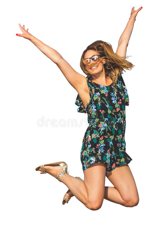 跳充满喜悦的妇女,隔绝在白色背景 太阳镜和微笑 免版税库存照片