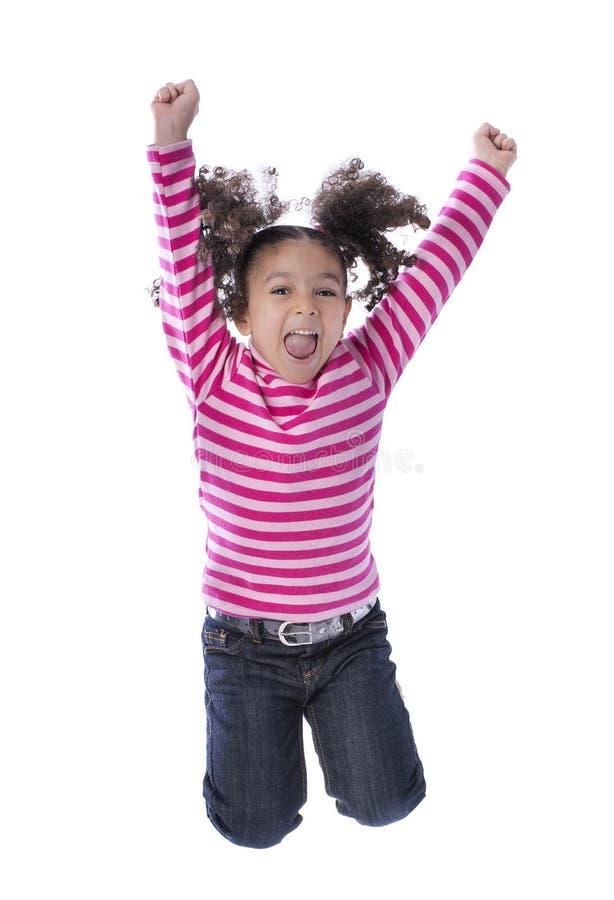 跳充满喜悦的小女孩 库存照片