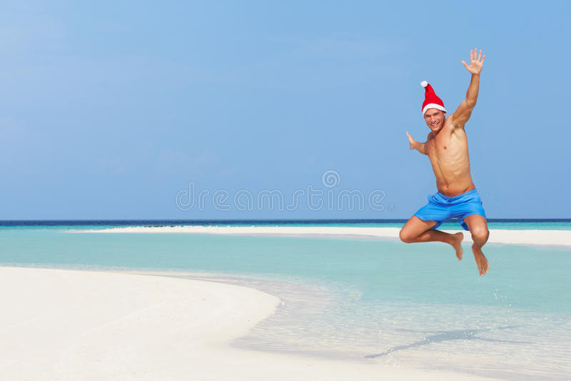 Download 跳在海滩的人戴圣诞老人帽子 库存照片. 图片 包括有 概念, 水平, 航空, 装饰, 复制, 马尔代夫, 中间 - 30329558