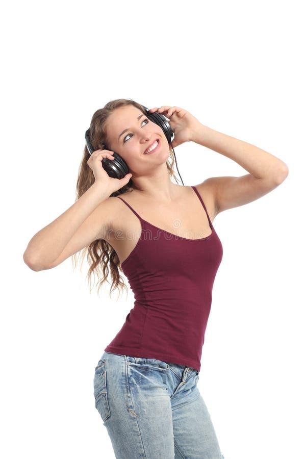 跳舞和听到音乐的俏丽的少年女孩 库存照片