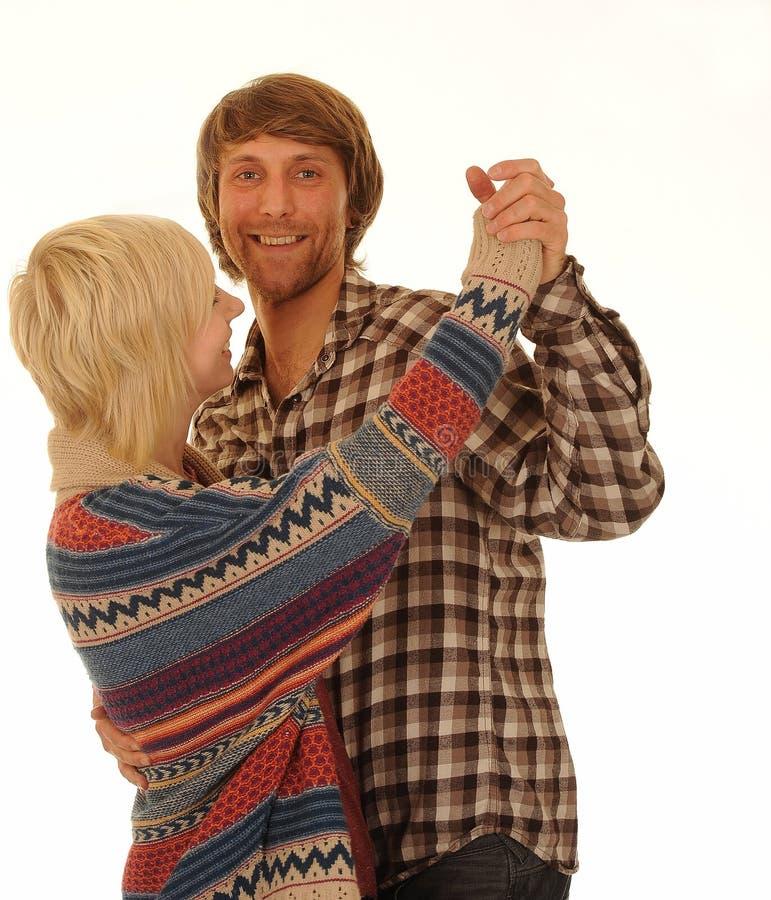 跳舞愉快的年轻人的夫妇 库存图片