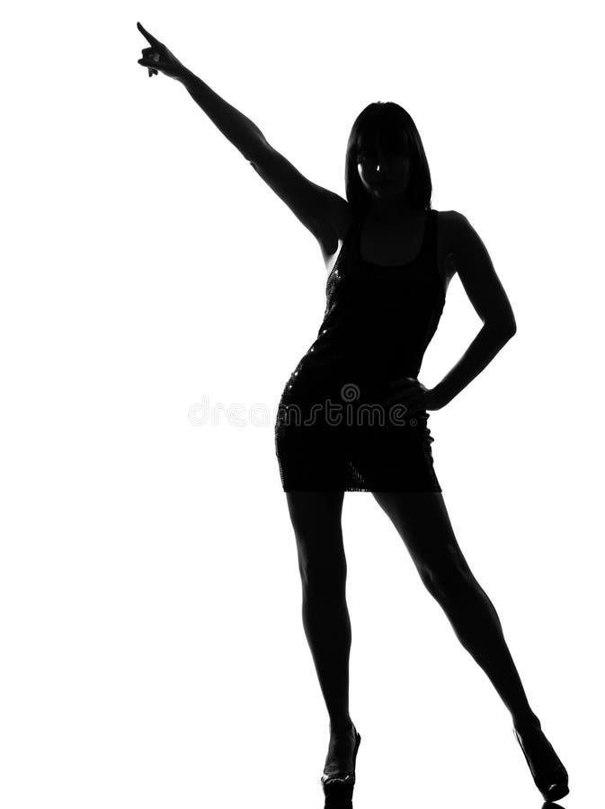 跳舞指向姿势剪影时髦的妇女 库存图片