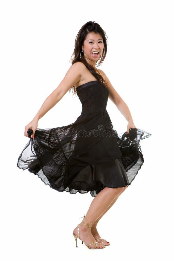 跳舞的俏丽的妇女 免版税库存照片