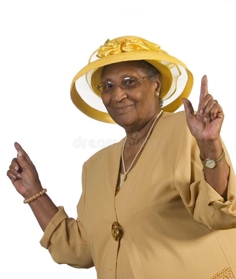 跳舞的愉快的老妇人 库存图片