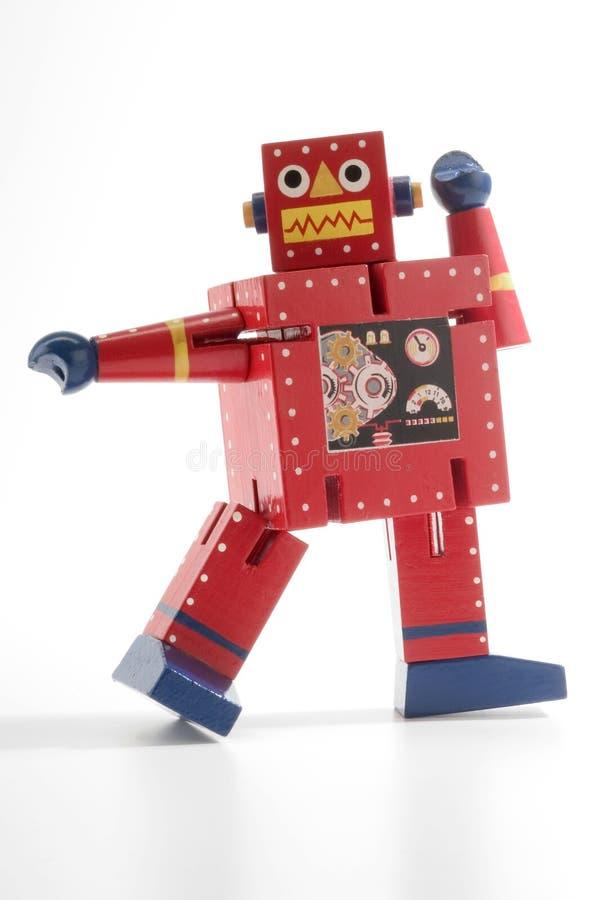 跳舞的红色机器人 免版税库存照片
