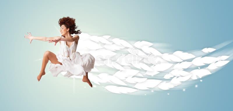 跳跃与羽毛的健康少妇在她附近 库存例证