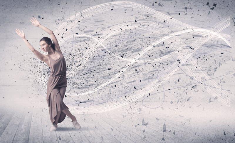 跳跃与能量爆炸微粒的表现跳芭蕾舞者 库存照片