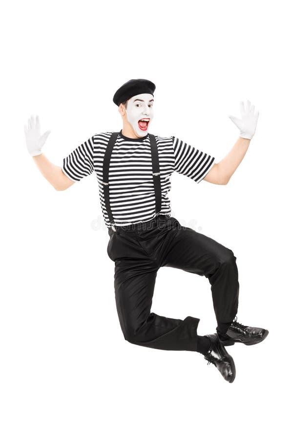 跳跃充满喜悦的笑剧艺术家全长画象 免版税库存图片