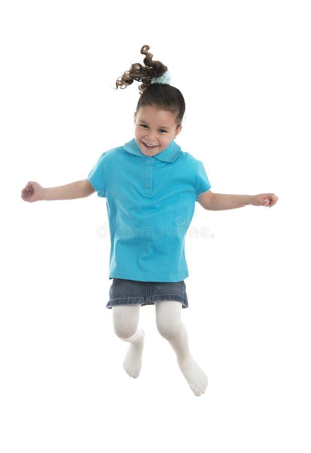 跳跃充满喜悦的活跃快乐的女孩 库存图片