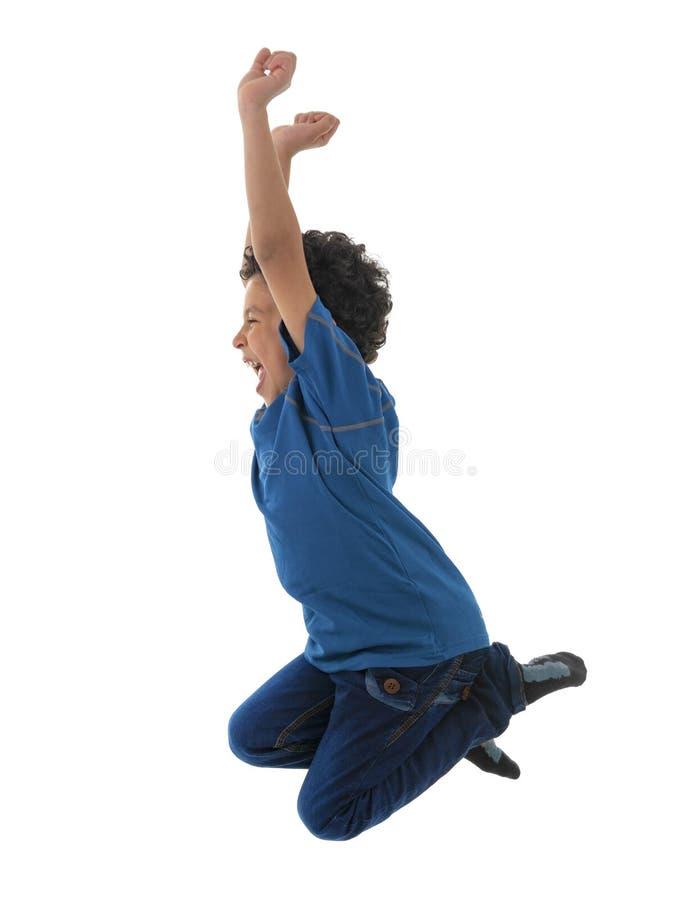 跳跃在天空中的年轻活跃愉快的男孩 库存图片