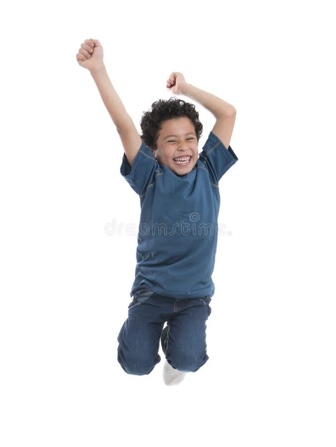 跳跃在天空中的愉快的男孩 免版税库存照片