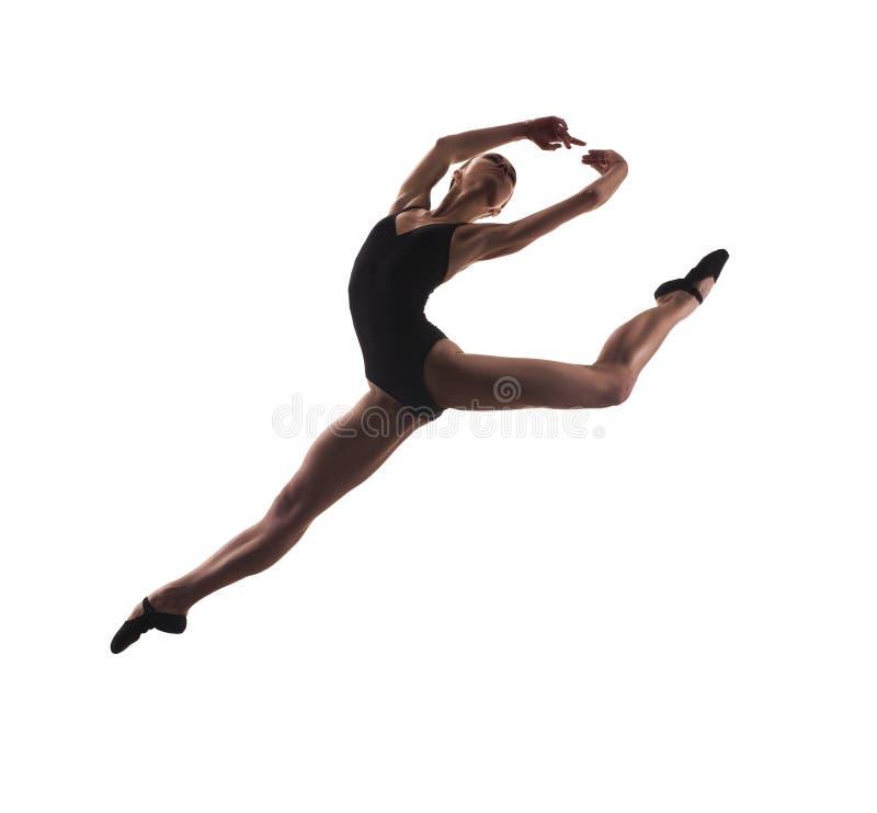 年轻现代跳芭蕾舞者跳跃 库存照片