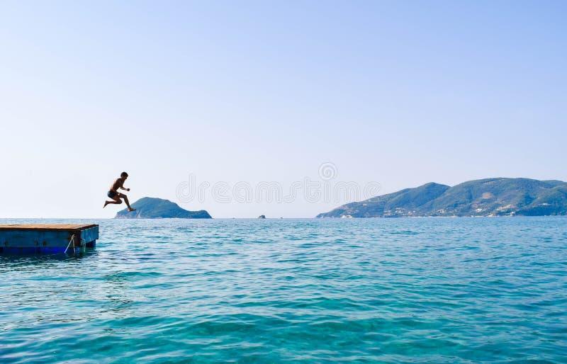 跳进从浮船的海 图库摄影
