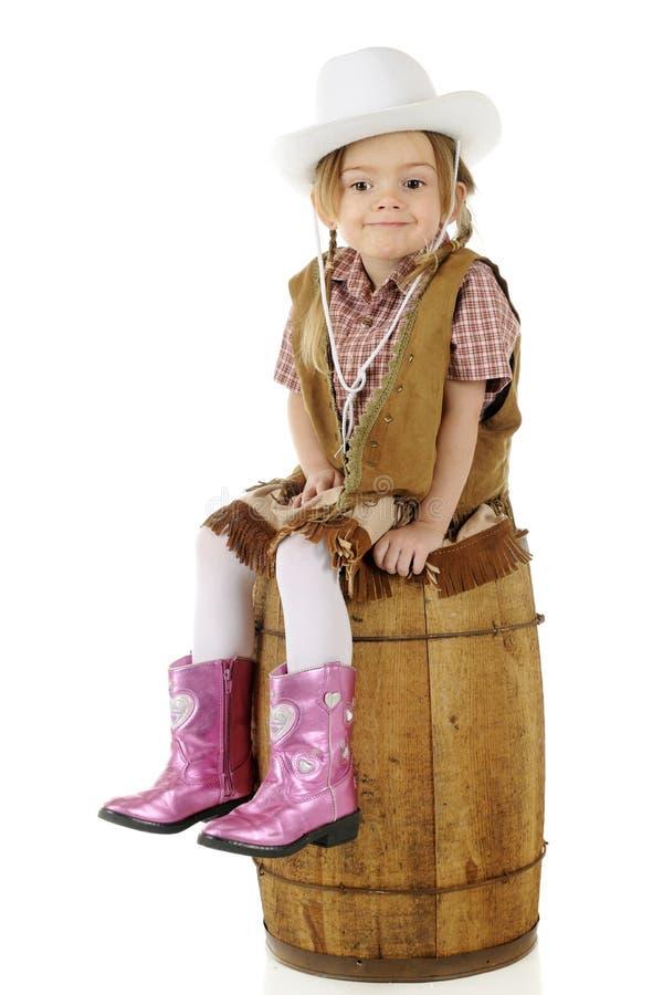 踌躇满志的矮小的女牛仔 免版税库存照片
