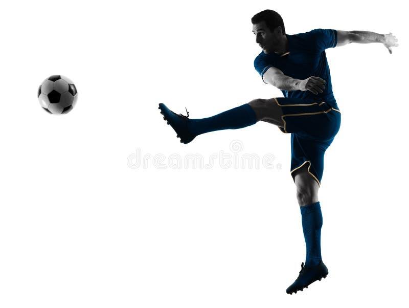 踢剪影的足球运动员人被隔绝 免版税库存照片
