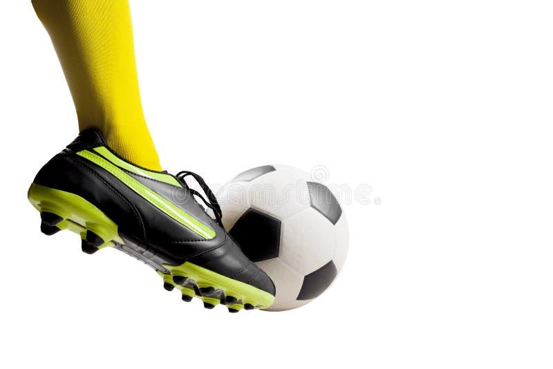 踢足球的足球运动员脚 库存照片