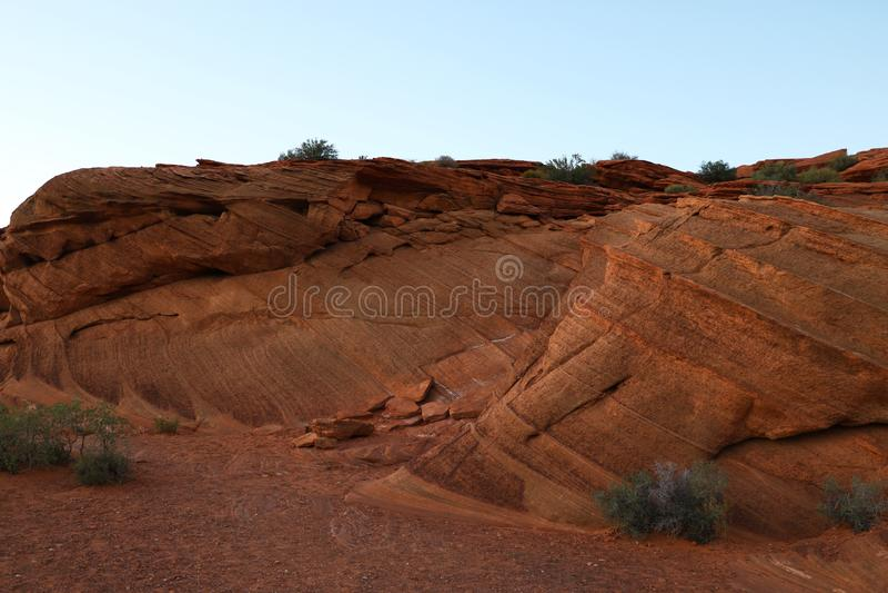 蹄铁湾亚利桑那红砂岩岩石特写镜头在日落期间的 库存照片