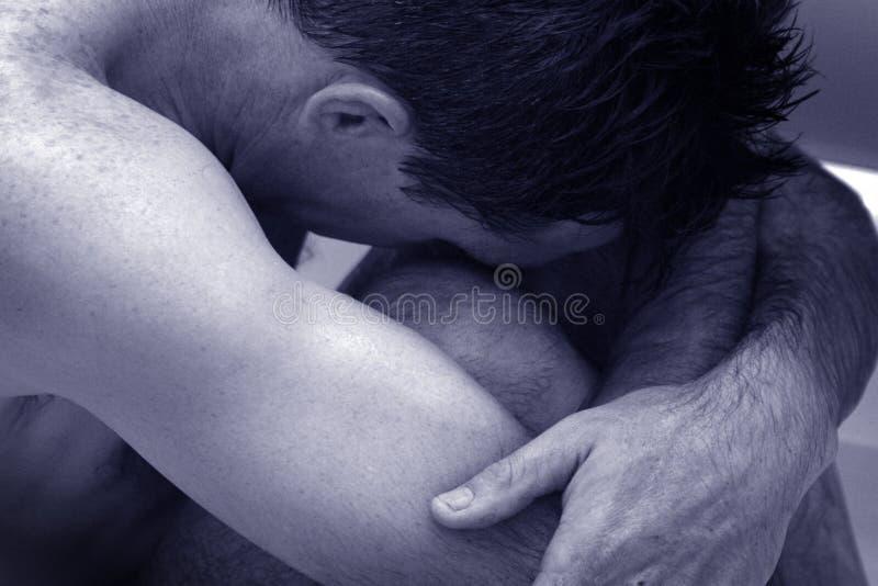 蹲下的人位置 免版税库存图片