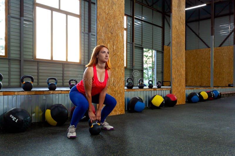 蹲坐技术与重量的 库存照片