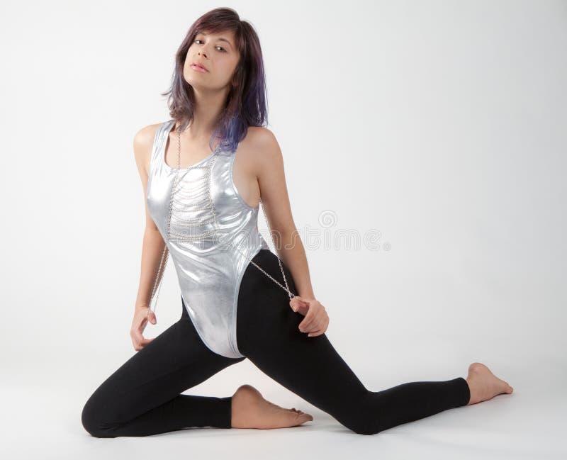 紧身连衣裤和绑腿的适合的妇女 图库摄影