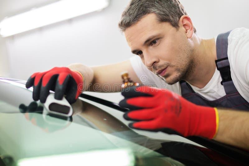洗车的工作者 免版税库存照片