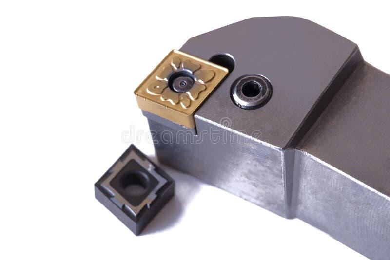 转动的切削刀 车床的设备在金属 金属切削设备 奶油被装载的饼干 图库摄影