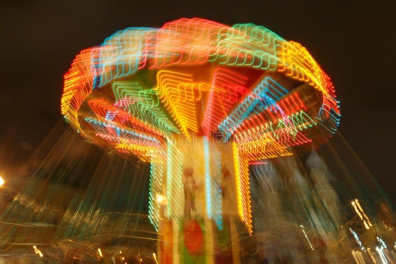 转盘光和运动,长的曝光摄影 免版税库存照片