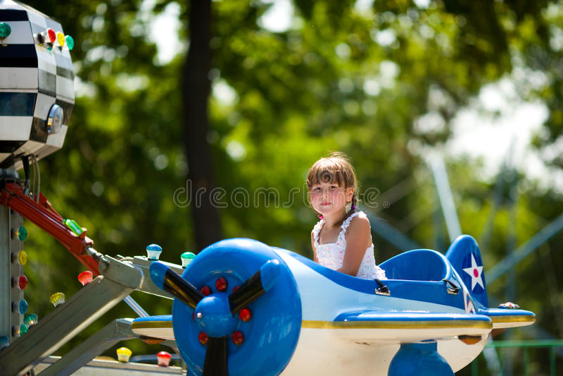 转盘女孩骑马 库存图片