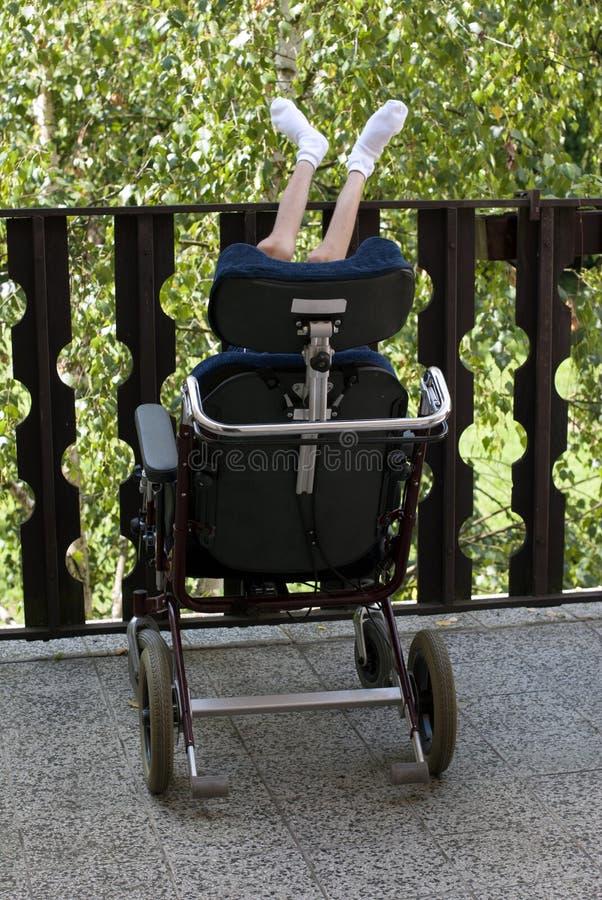 轮椅的残疾人 免版税库存照片